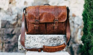 Leather satchel on stone surface
