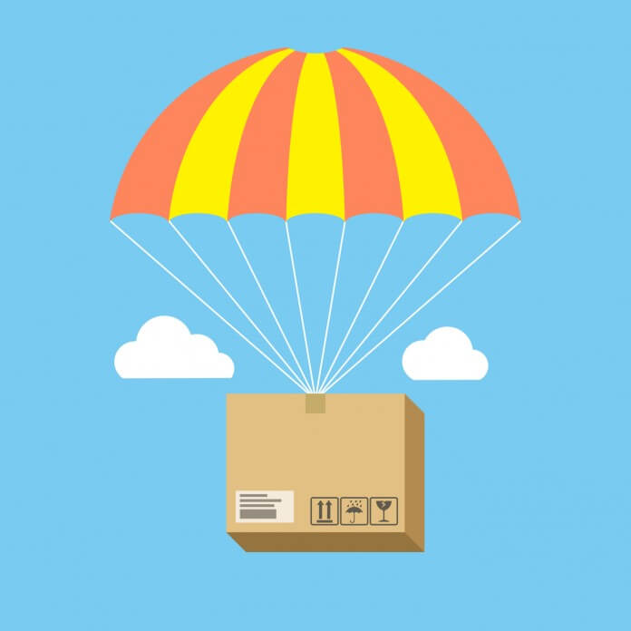 A package strapped to an orange and yellow parachute