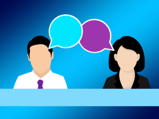Illustration of a man and woman in business attire with speech bubbles